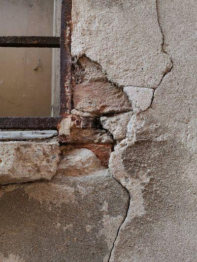 Close-up of damaged wall