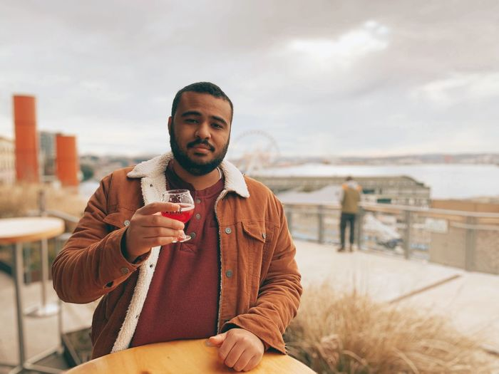 Portrait of a young man drinking drink