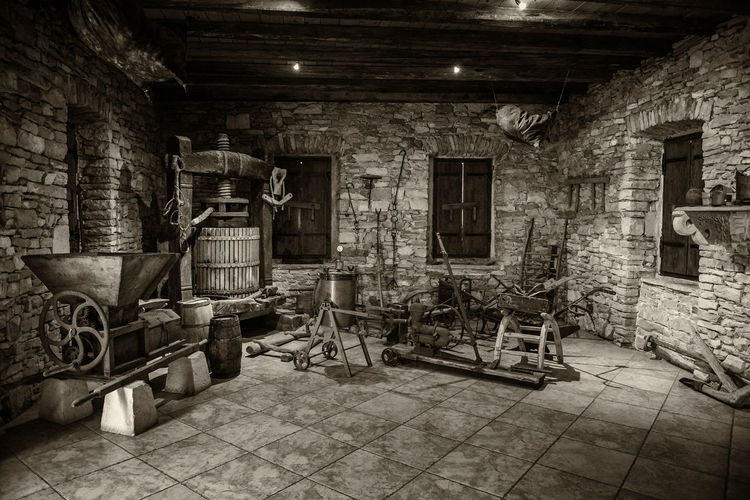 WINE MAKING OF YESTERDAY Animal Wine Skin Black & White Croatia Old Winery Sepia Wine Image Travel Wine Skins Antique Wine Pres Architecture Built Structure Flag Stones, History Illuminated Indoors  Monotone, No People Stone Building The Past Tourist Destination Vat Wall - Building Feature Window Wine Making, Wine Press, Wine Skins