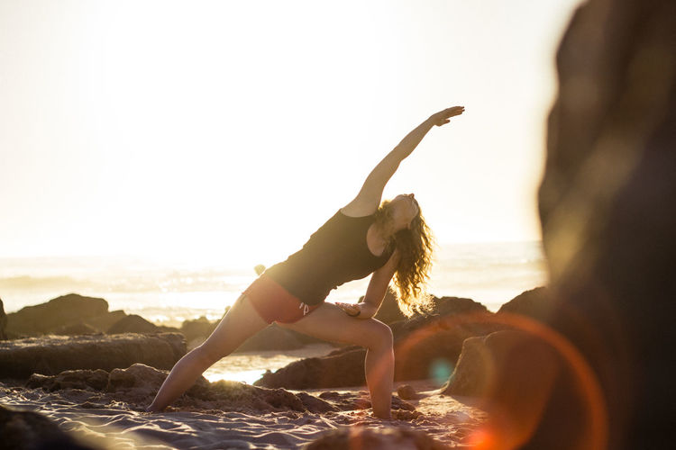 Yoga Lifestyle Beach Beach Yoga Healthy Lifestyle Lifestyles Nature Outdoors Sun Sunset Vitality Woman Yoga Yoga Pose Live For The Story
