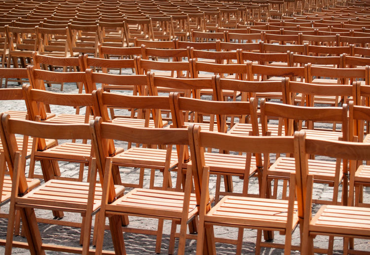 Full Frame Shot Of Empty Wooden Chairs Outdoors
