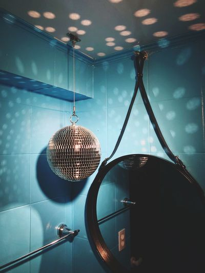 Disco ball hanging by mirror