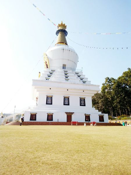 Architecture Built Structure Outdoors Building Exterior No People Sky Day Tibetan Buddhism India Dehradunphotographer Golden Hour In Action Beautiful Buddha Temple Tree Nature Buddha Park Architectural Column Clear Sky Grass Real Travel Destinations Buddha Statute Stupa Tibet Travel