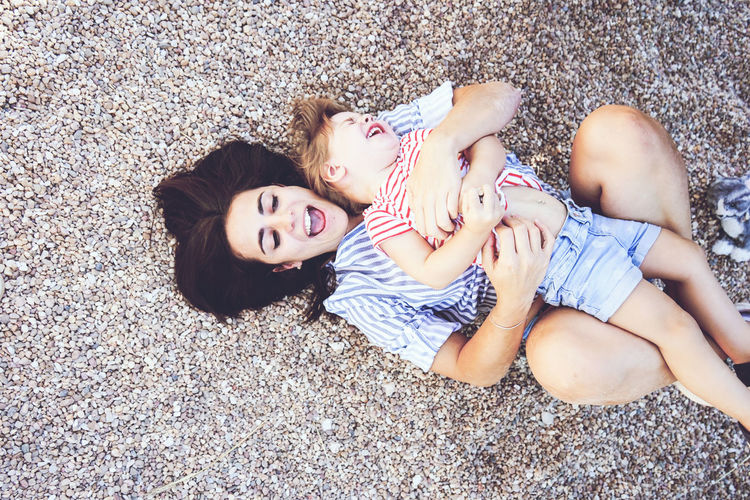 Emotion Togetherness Lying Down Real People High Angle View Two People Happiness Smiling Women Looking At Camera Childhood Females Family Child Bonding People Lifestyles Leisure Activity Portrait Love Positive Emotion Innocence Sister Outdoors
