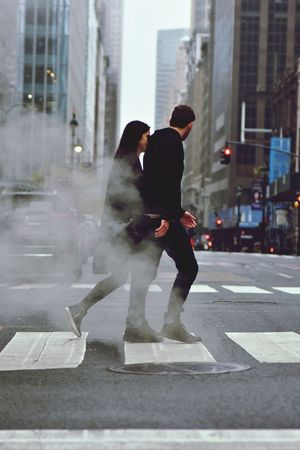 Two People City Street Adult Men Full Length Togetherness City Life Day People Adults Only Young Women Young Adult Road Motion Women Outdoors Standing Winter Warm Clothing Fog Stories From The City
