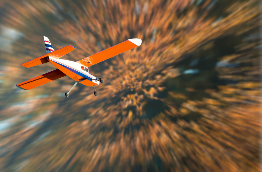 Aerospace Industry Air Vehicle Airplane Blurred Motion Corporate Jet Day Flying Journey Low Angle View Mid-air Mode Of Transportation Motion Nature No People on the move Orange Color Outdoors Plane Sky Speed Transportation Travel