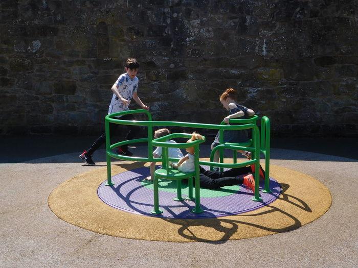 Children playing on merry-go-round