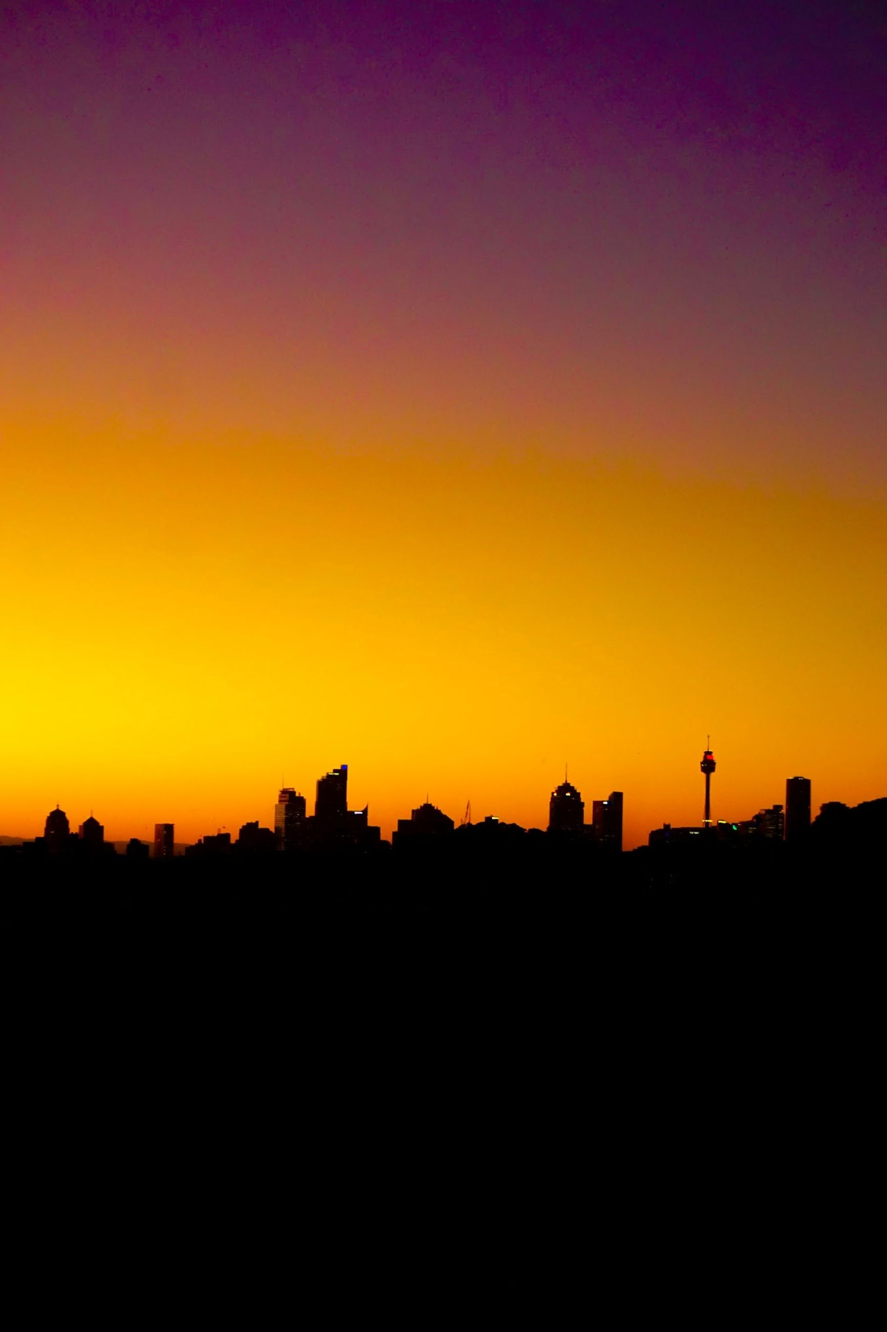 silhouette, sunset, sky, orange color, copy space, architecture, built structure, beauty in nature, no people, building exterior, scenics - nature, nature, landscape, tranquil scene, clear sky, outdoors, idyllic, tranquility, city, building, romantic sky
