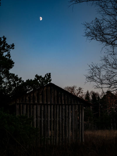 Tree Plant Moon Sky Nature No People Land Barrier Field Fence Architecture Boundary Built Structure Outdoors Tranquility Dusk Tranquil Scene Landscape Full Moon Beauty In Nature