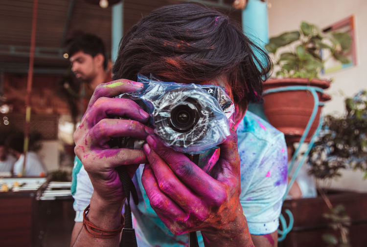 A photograph of a photographer taking a photograph of another photographer ... Holding Real People Portrait People Activity Lifestyles Photography Themes Focus On Foreground Camera - Photographic Equipment Adult Men Front View Leisure Activity Photographing Technology Occupation Young Adult Headshot Photographer Digital Camera Obscured Face Hairstyle Holi India Culture Tradition Indian Culture  Festival Colors Jodhpur Indoors  Rajasthan Party Holi Festival Hostel Travel Backpack Protection The Traveler - 2019 EyeEm Awards