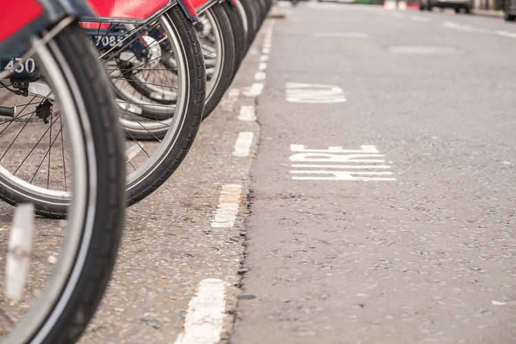 Cropped image of bicycle tires on road