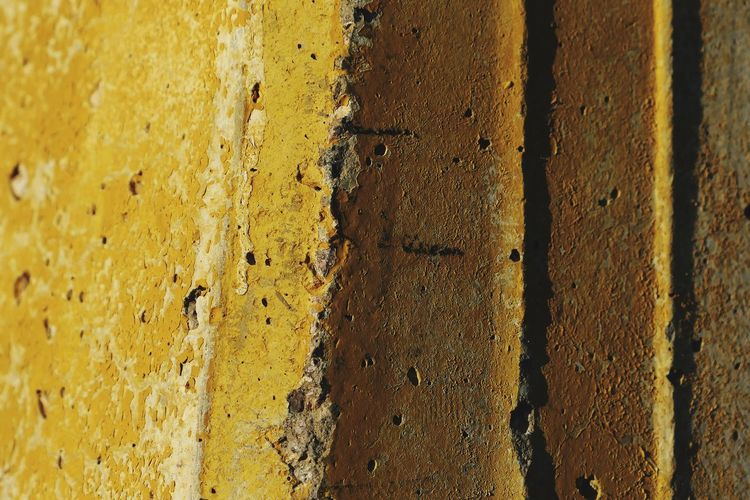 Full Frame Backgrounds Textured  Yellow No People Pattern Close-up Weathered Day Old Wall - Building Feature Built Structure Rough Architecture Rusty Outdoors Concrete Deterioration
