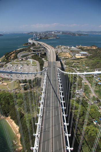 bridge in japan setonaikai Architecture Bridge Bridge - Man Made Structure Built Structure City Cityscape Connection Day Direction High Angle View Highway Motion Nature No People Outdoors Road Sea Sky The Way Forward Transportation Water