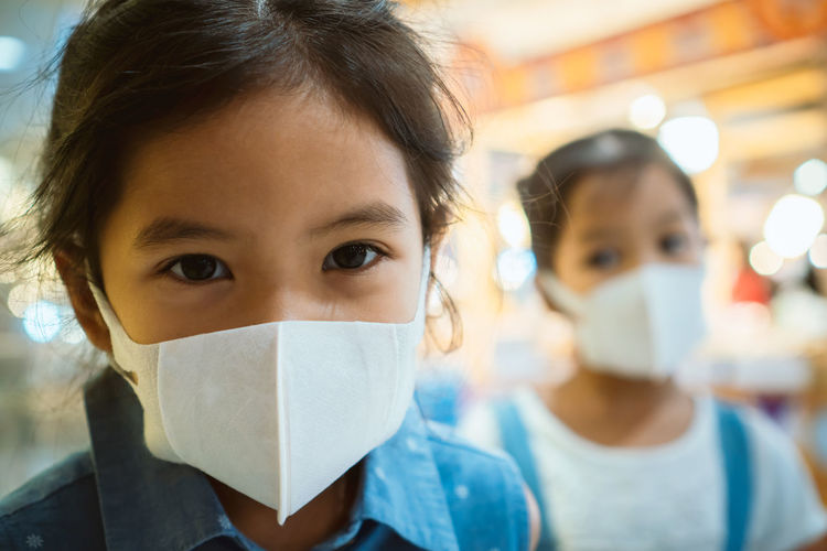 Cute asian child girl wearing protection mask to against air smog pollution with PM 2.5 in the city Air Allergy Asian  Breath Care Child City Contagion Covering Crowd Danger Disease Dust Environment Epidemic Face Filter Flu Girl Healthy Ill Infection Influenza Kid Lunge Mask Medical Patient People Pollution Prevention Protection Public Safety Sick Smell Smog Smoke Street Surgical Symtom Urban Virus Wearing Young Portrait
