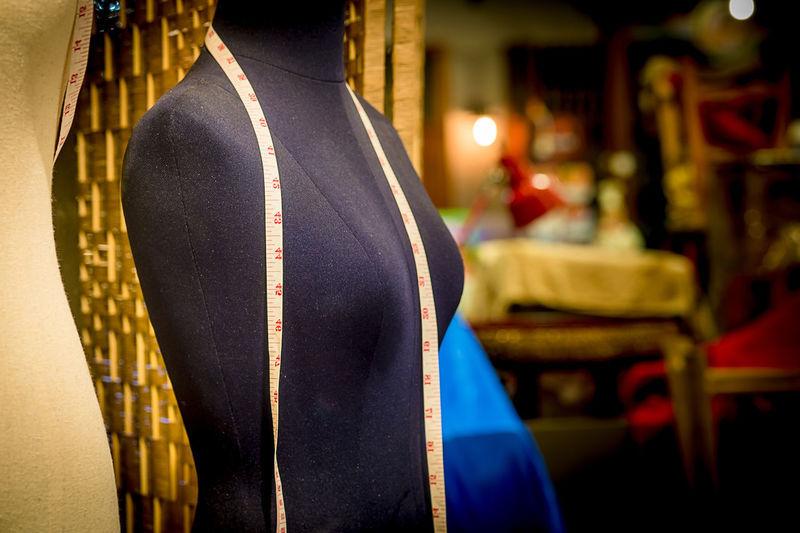 Close-up up measuring tape on mannequin at workshop