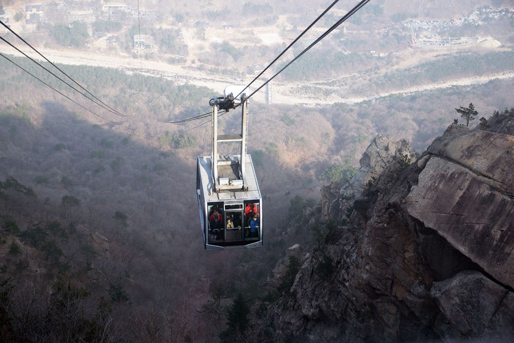 Cable car ride up to the mountains in korea.