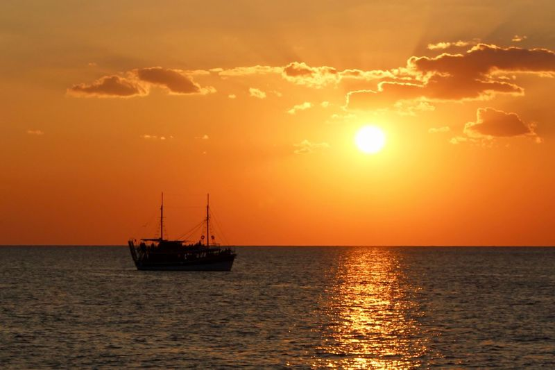 Silhouette Boat Moving On Sea Against Sky During Sunset