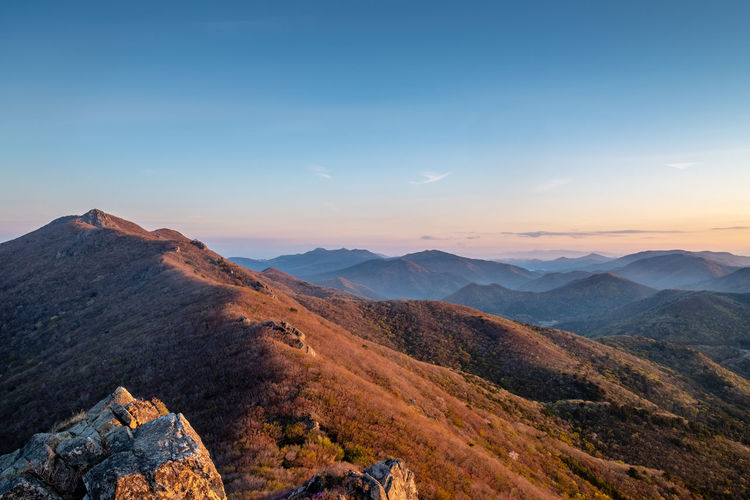 Mountain range and blue sky during sunrise Mountain Scenics - Nature Beauty In Nature Sky Tranquil Scene Tranquility Mountain Range Environment Non-urban Scene Landscape Idyllic Nature Remote No People Sunset Cloud - Sky Outdoors Sunlight Physical Geography Day Mountain Peak