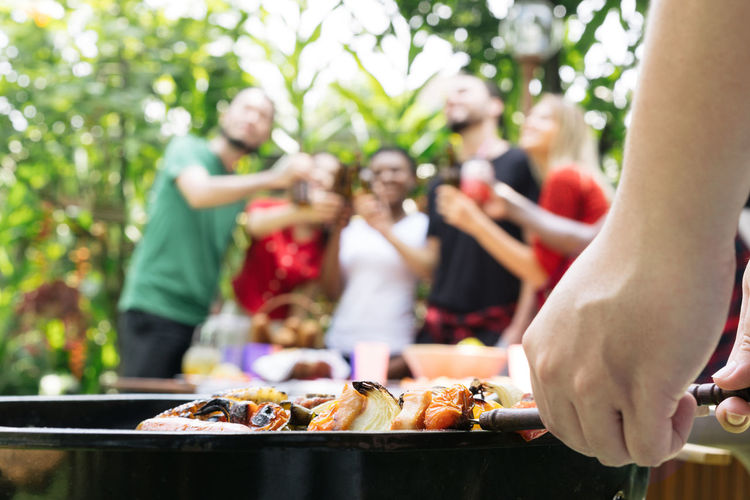 hand of bbq grilling and friends having barbecue party, outdoors Beer Beer - Alcohol Beer Glass Beers Drink Bottle Celebration Celebrating Celebrate BBQ BBQ Time Outdoors Park Garden Barbecue Barbecue Grill Grill Grilled Grilling African African Ethnicity Asian  Friendship Group Of People Food And Drink Food Women Men Group Focus On Foreground Adult Meat Leisure Activity Lifestyles Medium Group Of People Crowd Holding Real People Day Front Or Back Yard Social Gathering