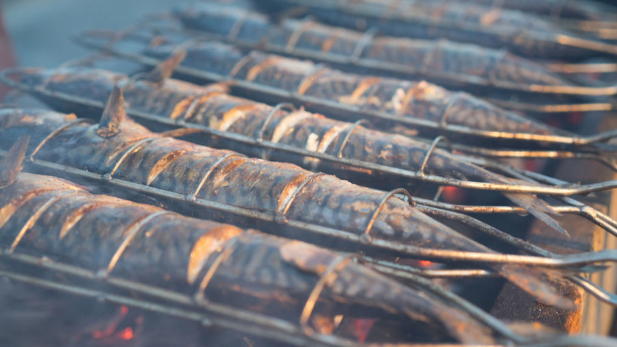 Close-Up Of Mackerels Cooking On Barbecue Grill