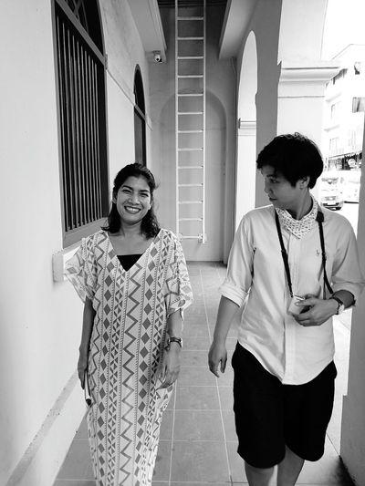 Friends walking in building corridor