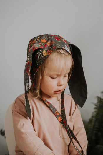 Toddler baby girl in funny hat with ears having fun