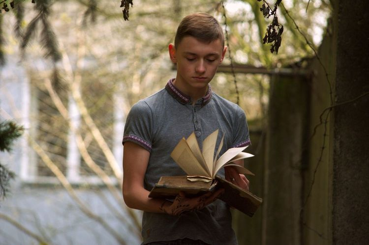 One Person Reading A Book Young Adult Outdoors Enjoying Life Taking Photos Great Atmosphere Warm Atmosphere