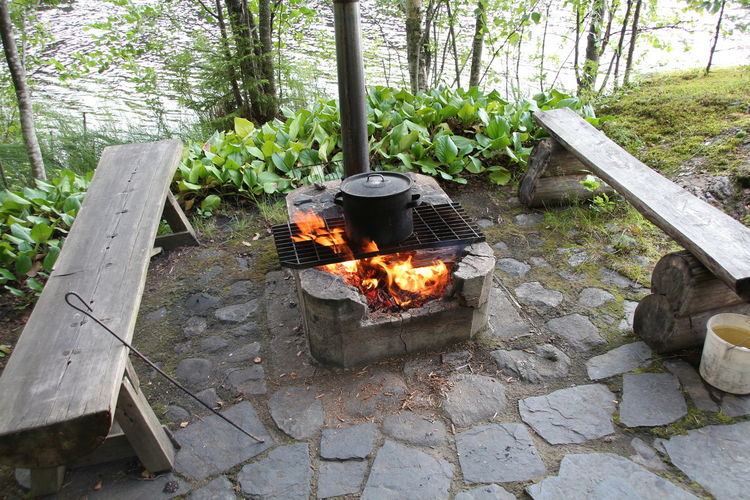 High Angle View Of Container On Stove Amidst Benches