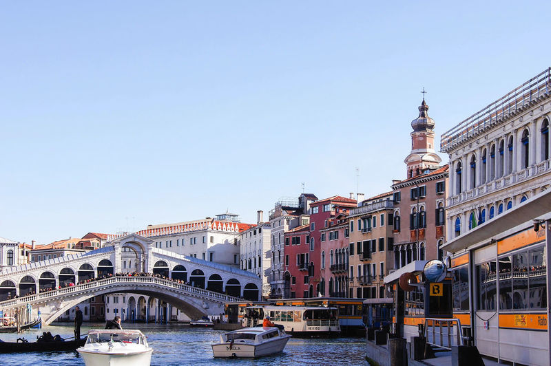 Rialto Reflection Venice, Italy Architecture Bridge Bridge - Man Made Structure Building Building Exterior Built Structure Canal City Clear Sky Connection Copy Space Day Incidental People Mode Of Transportation Nature Nautical Vessel Outdoors Sky Transportation Travel Destinations Vaporetto Station Water