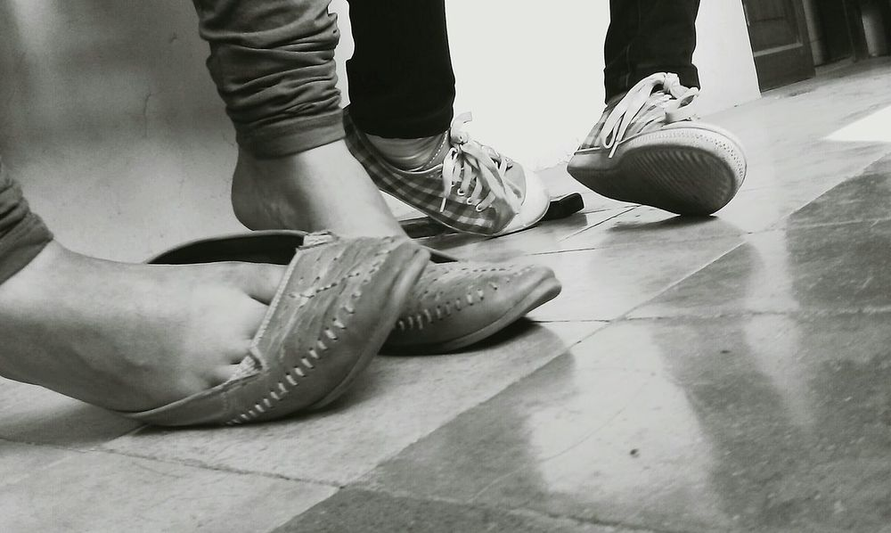 Quaint and Quirky Fuß Stumbling Shadow Feet Human Body Part Friendship Day Black And White Illuminated Black And White Photography Mobile Photography Shoes Sneakers Casual Casual Style Casual Shot Tiles Perspective Open Edit Eyeem Collections EyeEm Gallery EyeEm Best Shots EyeEm Best Shots - Black + White captured by HTC Desire U Dual Sim