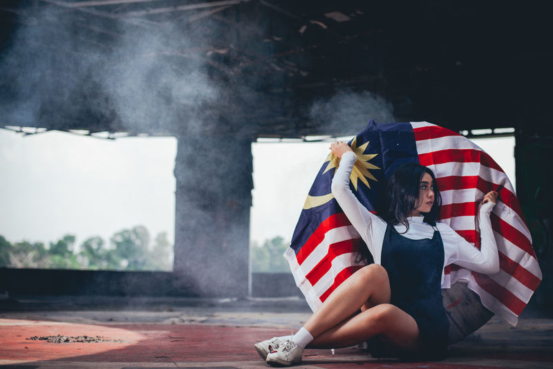 Architecture Day Emotion Flag Freedom Independence Lifestyles Men National Icon Outdoors Patriotism People Pride Real People Smoke - Physical Structure Striped Women