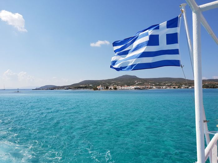 Beauty In Nature Blue Cloud - Sky Clouds Clouds And Sky crystal clear Crystal Clear Waters Day Ferry Views Flag Greece Greek Flag Island Nature No People Outdoors Samsungphotography Scenics - Nature Sea Sky Tranquil Scene Tranquility Turquoise Colored Water Wind