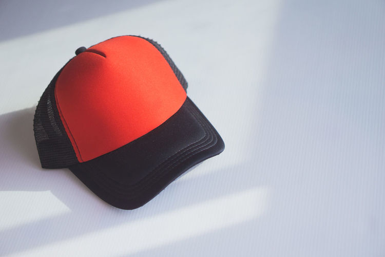 High angle view of hat on table against white background