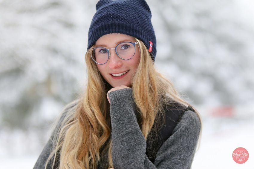 Winter girl EyeEm Selects One Person Winter Smiling Real People Clothing Looking At Camera Warm Clothing Young Women Young Adult Hat Portrait Lifestyles Cold Temperature Glasses Focus On Foreground Beautiful Woman Happiness Knit Hat