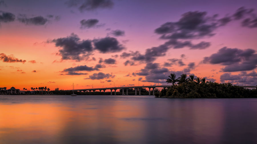 A bridge in Florida at sunset. Sunset Sky Water Cloud - Sky Beauty In Nature Scenics - Nature Tranquility Tree Waterfront Orange Color Tranquil Scene Nature No People Reflection Plant Silhouette Lake Idyllic Outdoors Bridge Bridge - Man Made Structure Flora Sunset_collection