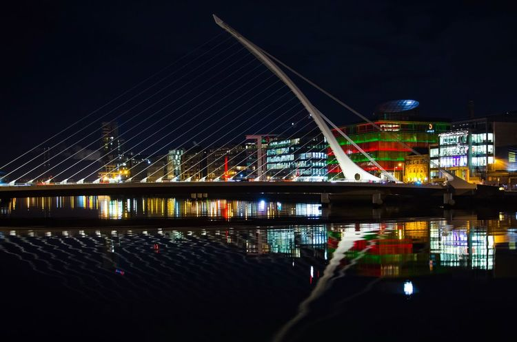 Dublin by night Dublin Illuminated Night Architecture Built Structure City Bridge - Man Made Structure Building Exterior Modern Reflection River Outdoors Cityscape Water Sky Travel Destinations Connection EyeEmNewHere EyeEmNewHere