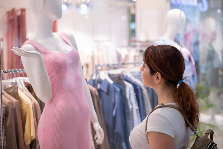 Woman looking away at store