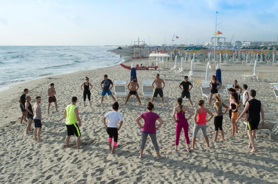 Beach Circle Coastline Fitness Large Group Of People Leisure Activity Lifestyles People Sea Sport Summer People Of The Oceans Viareggio Italy People And Places Beautifully Organized Enjoy The New Normal