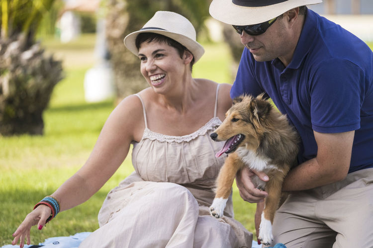 Man and woman with dog outdoors