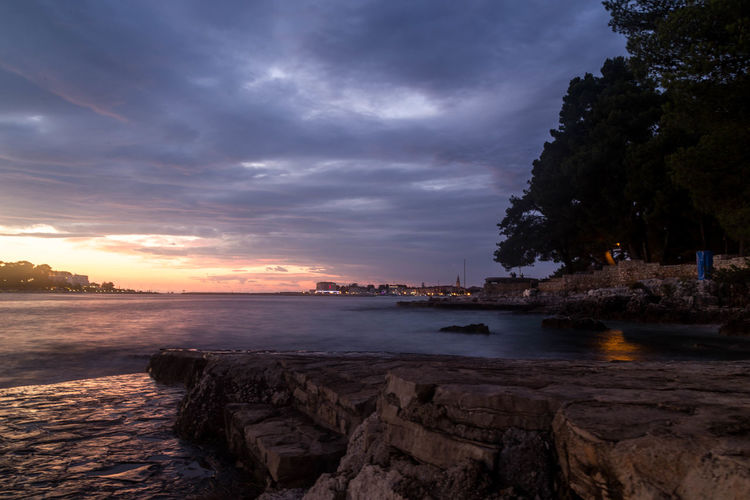 Croatian long exposure... Croatia Holiday Porec, Croatia Poreč Town Travel Beach Beauty In Nature Cloud - Sky Croatian Dusk Croatian Landscape Dusk Horizon Over Water Nature Porec Rock - Object Scenics Sea Sea And Sky Seascape Sky Sunset Sunsets Tranquil Scene Tranquility Water