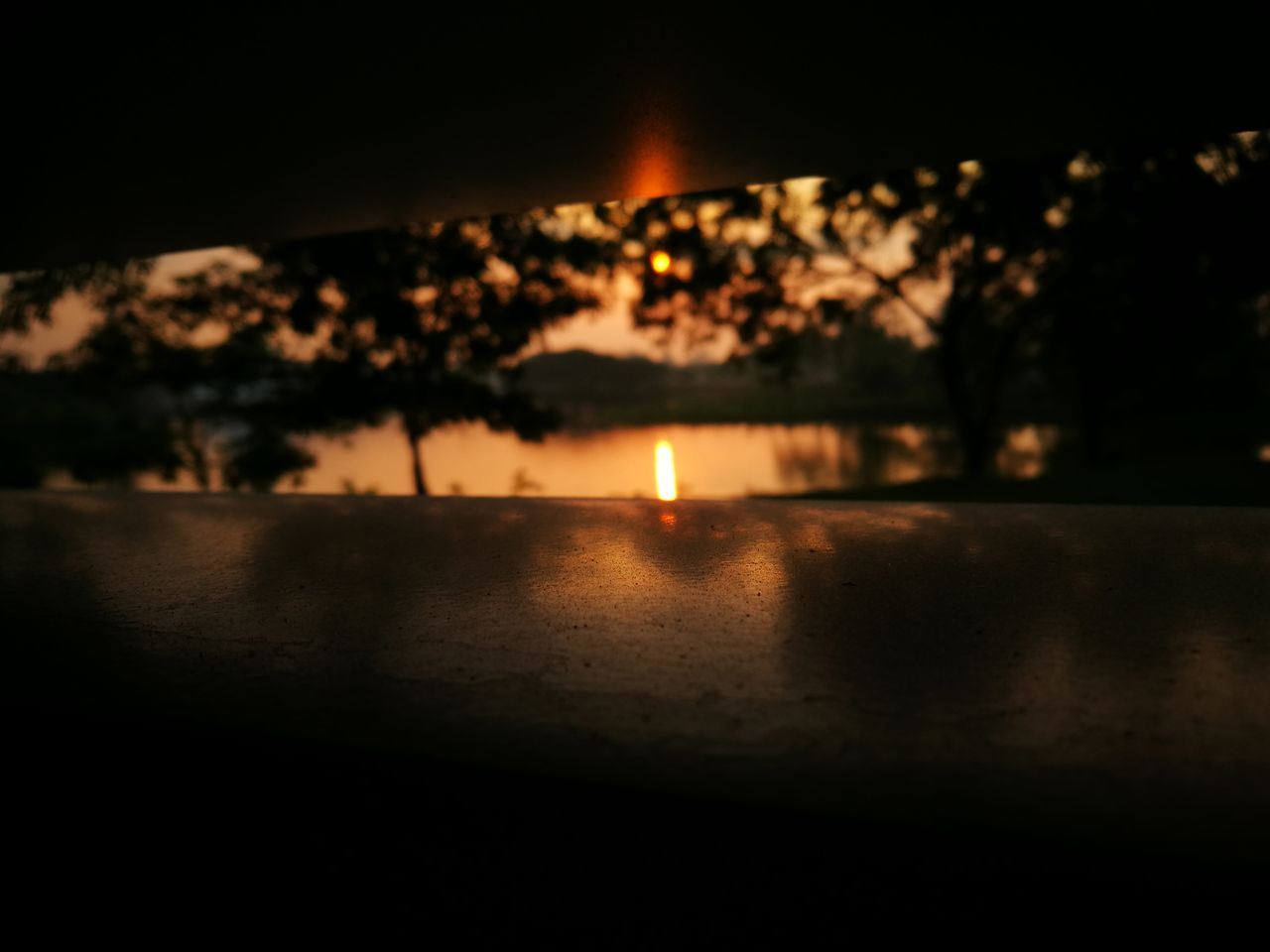 night, burning, no people, flame, illuminated, water, sunset, tranquility, outdoors, sky, scenics, nature, beauty in nature, close-up, diya - oil lamp