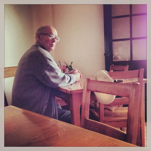 Adult Chair Day Eyeglasses  Glasses Holding Indoors  Lifestyles Oldman One Man Only One Person Only Men People Real People Sceptical Side View Sitting Table Working