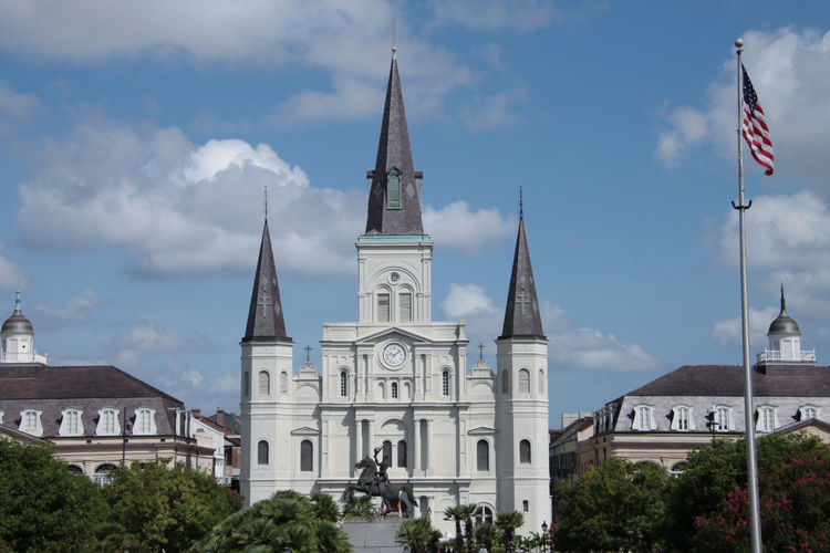 St. Louis Cathedral Architecture Belief Building Building Exterior Built Structure Cloud - Sky Day Flag Government Nature No People Outdoors Place Of Worship Plant Religion Sky Spire  Spirituality Tower Travel Travel Destinations