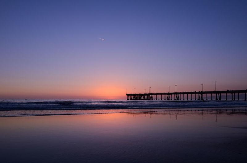 Silhouette Santa Monica Pier Over Sea During Sunset