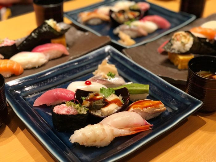 Close-up of sushi in tray on table