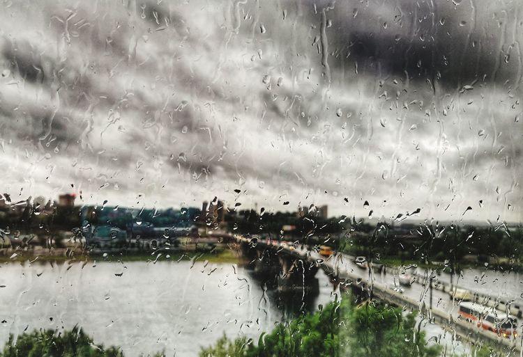 Raindrops on glass window of rainy season