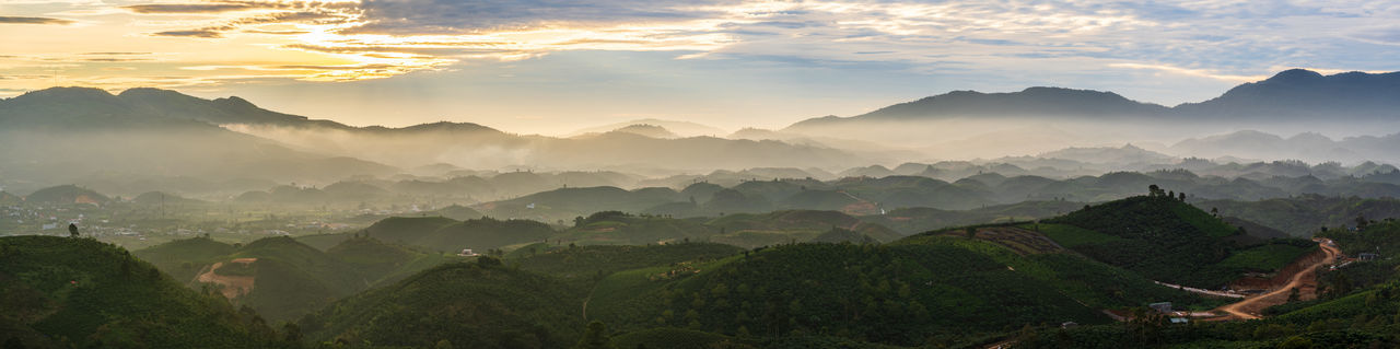 Panoramic view of mountains against sky during dawn