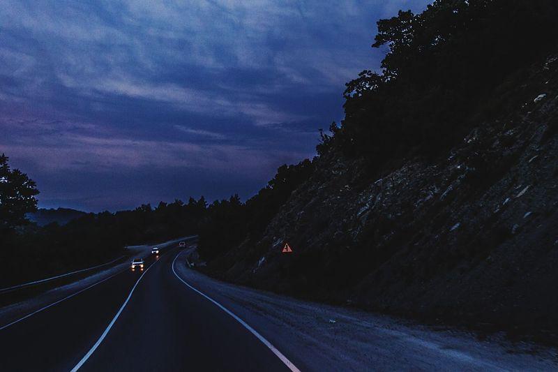 Road against sky at dusk