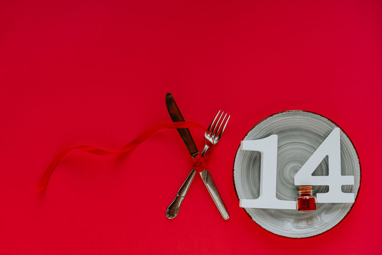 High angle view of lamp on table against red background