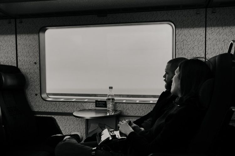 Train Ride Train Train - Vehicle People In Transit Transitional Moments Transit Window Train Car Couple Black And White Black And White Photography Looking Through Window Glass Autumn Mood